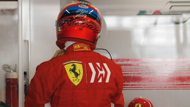 Ferrari driver Kimi Raikkonen sports the Mission Winnow logo on his racing uniform.