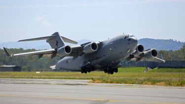 A C-17 Globemaster leaves RAAF base for Vanuatu after Cyclone Pam in 2017.