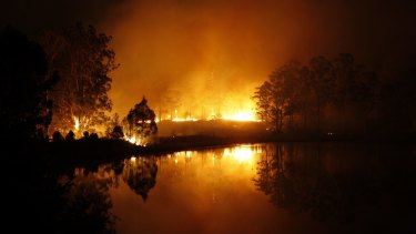 Hillville fire reflects on water during the out-of-control fire on Tuesday evening.