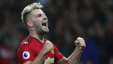 Manchester United's Luke Shaw celebrates after scoring his sides second goal of the game during the English Premier League soccer match between Manchester United and Leicester City at Old Trafford, in Manchester, England, Friday, Aug. 10, 2018.
