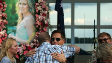 Don Damond hugs a loved one prior to a memorial service for his fiancee, Justine Damond, in August last year.