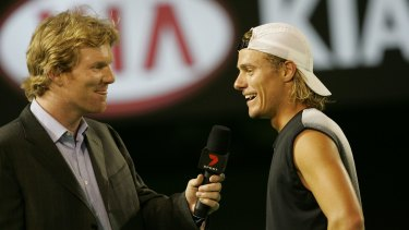 Jim Courier chats with Lleyton Hewitt on court at the 2005 Australian Open. Courier and Hewitt will share the commentary box again at this year's Open.
