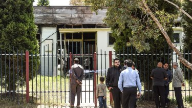 Community members outside the Imam Ali Islamic Centre in Fawkner after the December 2016 fire