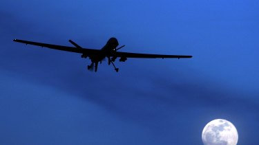 An unmanned US Predator drone flies over Kandahar Air Field, southern Afghanistan, on a moon-lit night.