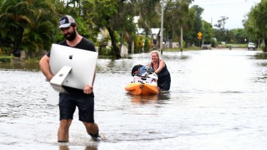 Local residents salvage items from their flood-affected home in the suburb of Hermit Park in Townsville on February 6, 2019.