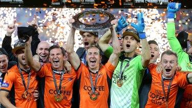 Better days: Brisbane Roar taking out the 2014 A-League title.