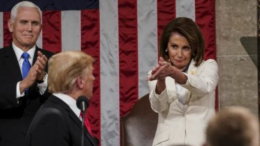 Donald Trump turns to Speaker Nancy Pelosi as he delivers his State of the Union address.