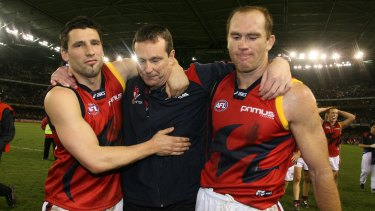 Russell Robertson and then Melbourne captain David Neitz walk off the ground with former coach Neale Daniher after his last game in 2007.