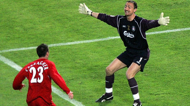 Life changing: Jamie Carragher and Jerzy Dudek celebrate.
