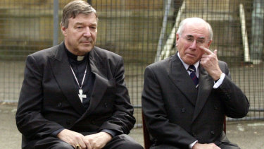 Cardinal George Pell and then prime minister John Howard at a media call at St Benedict's Church in August 2004.