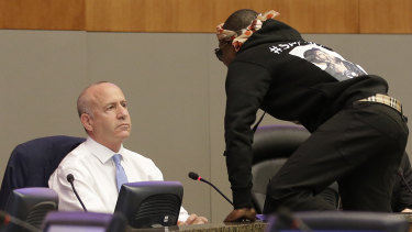 Stevante Clark jumped on the dais and shouts at Sacramento Mayor Darrell Steinberg during the council meeting.