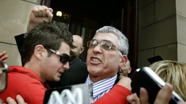 Mick Gatto walks free from the Supreme Court after being aquitted of murdering Andrew Veniamin in a Carlton restaurant in 2004