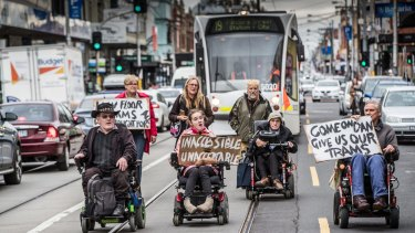 Brian Caccianiga (black hat) and fellow disability advocates blocked trams on Sydney Road in Brunswick earlier this year.