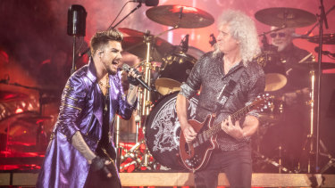 Adam Lambert and Brian May, with Roger Taylor on drums.