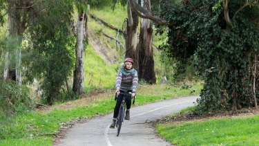 A cyclist on part of the bike path along Merri Creek.
