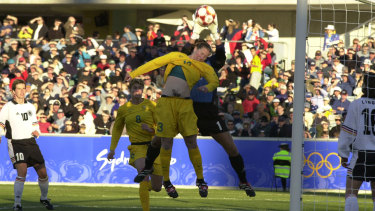 Alicia Ferguson making life uncomfortable for the German goalkeeper at the 2000 Sydney Olympic Games.