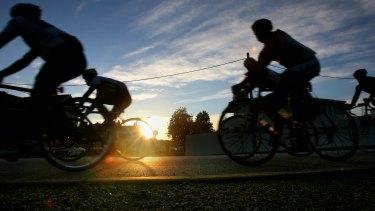 Dawn patrol: cyclists on Melbourne's Beach Road.