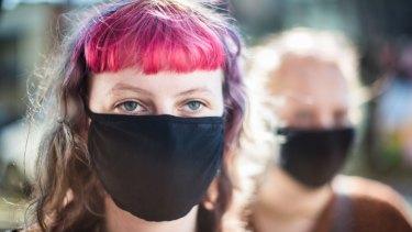 People wearing masks on Brunswick Street, Fitzroy, Melbourne.