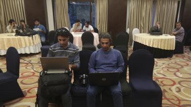 Journalists work inside a media centre set up by Jammu and Kashmir authorities in Srinagar, Indian controlled Kashmir.
