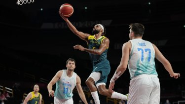 Hoop dreams: Patty Mills breezes past Luka Doncic (77) and Mike Tobey (10) for an easy basket.
