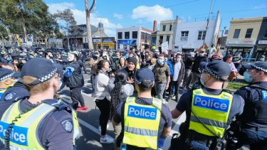 Dozens of police descended Queen Victoria market after anti-lockdown protesters marched through the iconic site as part of a 'Freedom Day' protest.