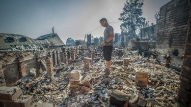 John Blankenstein visits the home of his parents-in-law to see the devastation caused during the Tathra bushfires.