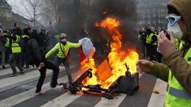 Demonstrators set a fire on the Place de la Republique after a yellow vest protest in February.