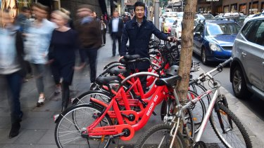 Reddy Go founder Donald Tang with dozens of bikes ready to hit the streets last July.
