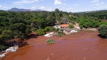 An aerial view shows flooding triggered by a collapsed dam near Brumadinho, Brazil, on Friday.