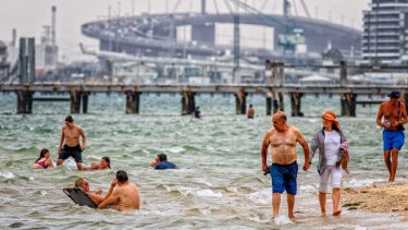 Seeking relief from the hot weather at Port Melbourne beach in January.
