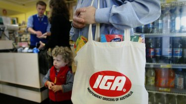A group of prominent IGA store owners have banded together to form a new grocery buying cooperative.