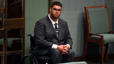 Greens Senator Jordon Steele-John listens to Prime Minister Scott Morrison move a motion in support for a royal commission into the abuse of disabled people, in the House of Representatives.