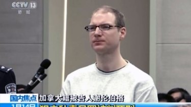 Canadian Robert Lloyd Schellenberg attends his retrial at the Dalian Intermediate People''s Court.