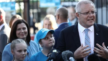 Prime Minister Scott Morrison with wife Jenny Morrison and daughters Lily and Abby after voting at Lilli Pilli Public School in Sydney.