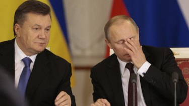 Russian President Vladimir Putin, right, with his Ukrainian counterpart Viktor Yanukovych in Moscow in 2013.