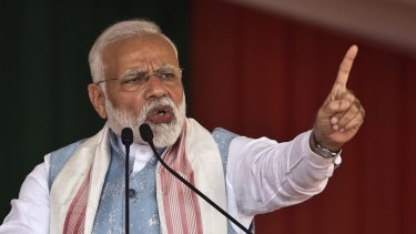 Indian Prime Minister Narendra Modi addresses a public rally in Changchari, on the outskirts of Gauhati, India, on Saturday.