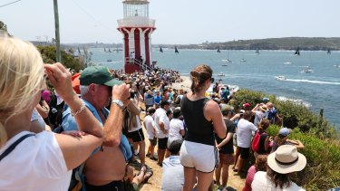 Crowds at South Head watch the start of the Sydney to Hobart.