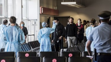 Passengers at Sydney Airport going through health screening after arriving from Melbourne earlier this month.