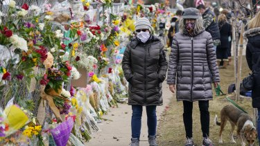 Mourners at supermarket in Boulder, Colorado, where 10 people died in a mass shooting in March.