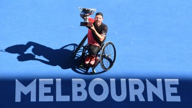 Dylan Alcott triumphs at the Australian Open in January.