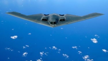 A B-2 stealth bomber flying over the Pacific Ocean.