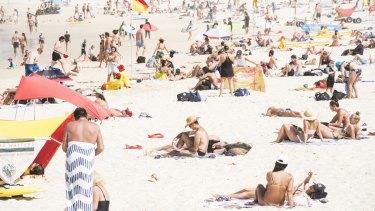 Beachgoers at Bondi Beach on Saturday morning before the beach was closed.
