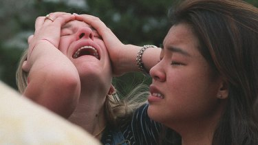 Students at a triage near Columbine High School after the mass shooting in 1999.