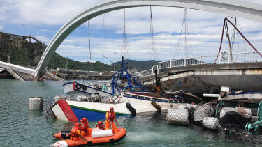 Rescuers work near the site of a collapsed bridge in Nanfangao, eastern Taiwan.