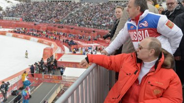 Russian president Vladimir Putin and sport minister Vitaly Mutko watch the 2014 winter Olympics in Sochi.