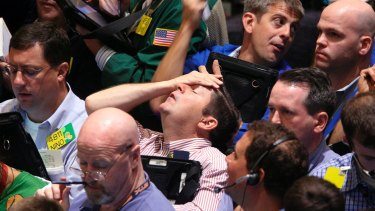 Wall St traders in September 2008. After the global financial crisis, central banks around the world introduced quantitative easing programs.