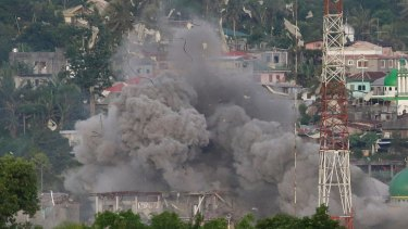 A cloud of debris rises as Philippine fighter jets bomb a suspected Islamist militant location in Marawi during a protracted battle in 2017.
