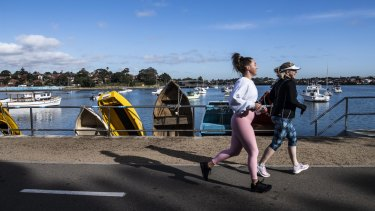 Runners at a popular stretch along Sydney Harbour at Lilyfield.