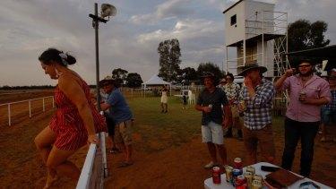 Revellers enjoy the race-day festivities.