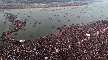 Thousands of Hindu pilgrims take a ritualistic dip on the auspicious day of Basant Panchami at Sangam on Sunday.